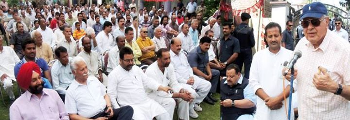 NC president Dr Farooq Abdullah addressing party workers at Paloura on Sunday.