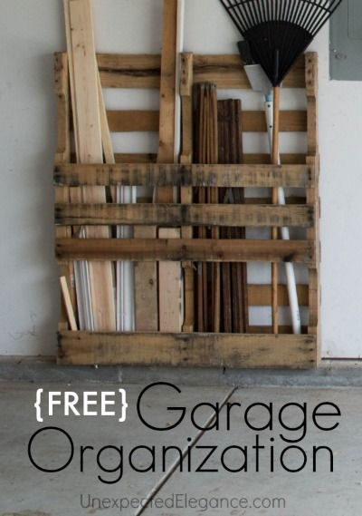 Use an old palette to make super easy DIY garage storage for all your yard equipment.