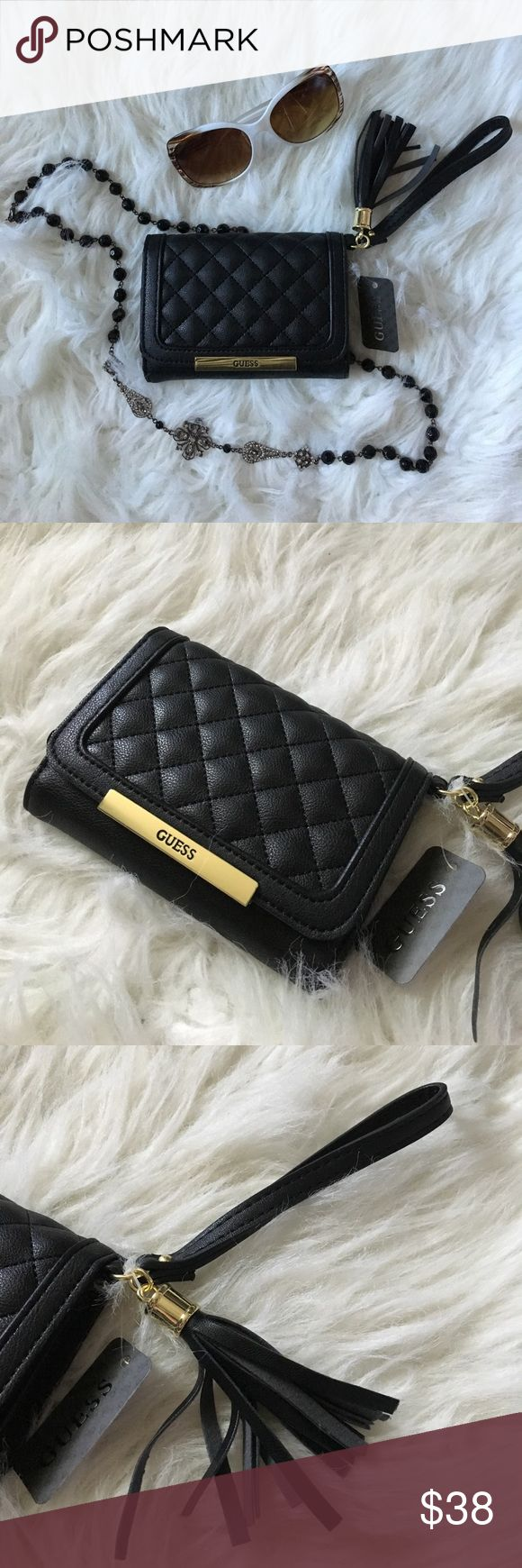 """GUESS, Quilted Cell Phone Wristlet GUESS, Quilted Cell Phone Wristlet   Beautiful Black Quilting Make up the front Flap of this Uber Chic Wristlet   Gold Hardware and Logo w. Tassel Accent   Three card slots + Window and a Larger Slot behind Cell Phone Sleeve • Measures 5.5"""" L x 4"""" H x 1.25"""" D closed 📱 Fits iPhone 6/6S 💙 Reasonable Offers Please Guess Bags Clutches & Wristlets"""