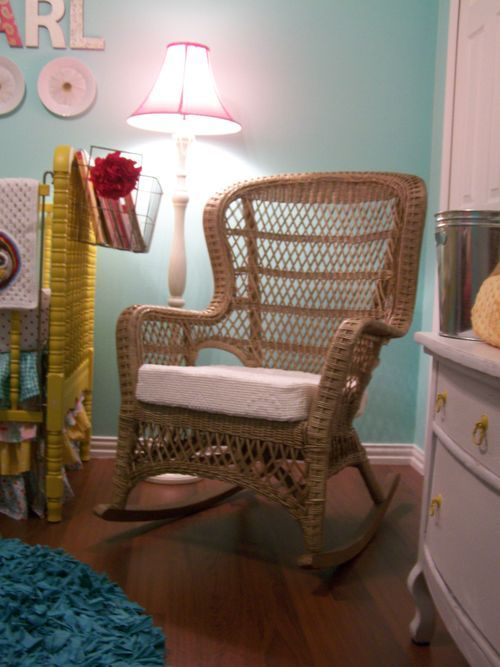 Love the idea of using a wicker rocker instead of the more traditional glider