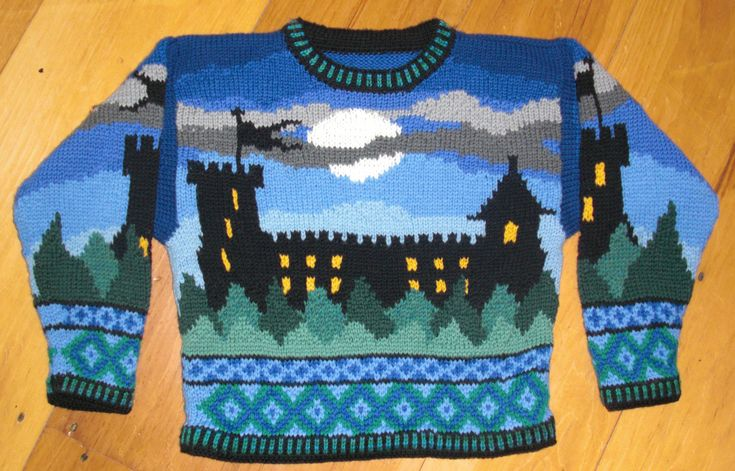 This is a PDF instant file. This is a pattern for a sweater for a four year old boy or girl. The back and front are identical. A darkened castle stands tall above evergreen trees and against a fading blue night sky, with the moon and clouds. Lights in the castle glow bright yellow. The sleeves are also identical, though the images are reversed. On the sleeves a single tower of the castle stands against the same blue sky and green trees. At the sleeves and hem are two trims: of blue crosses…