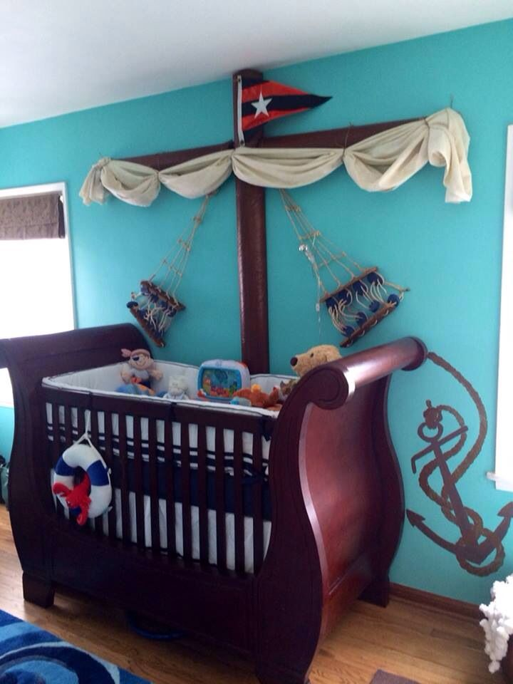 Gunner's pirate ship crib in his nautical nursery.