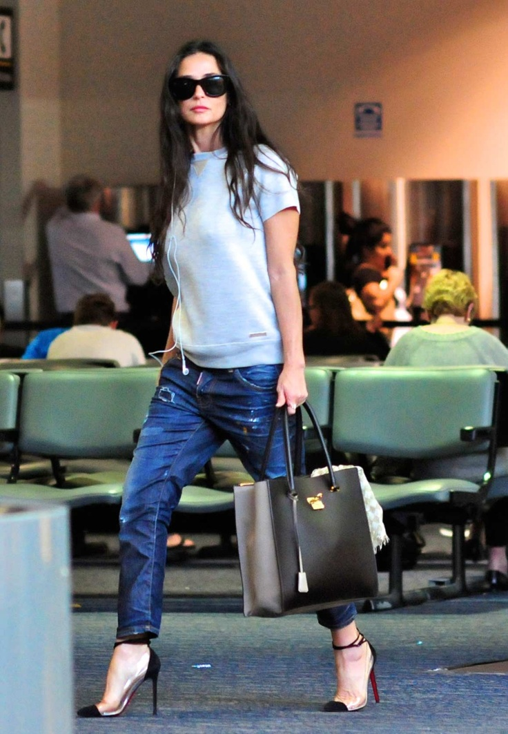 Demi Moore carrying a Salvatore Ferragamo tote.. she is just cool...