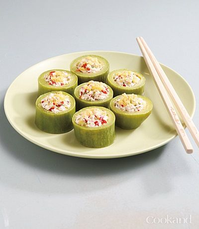 Korean Buddhist Cuisine - Steamed tofu-stuffed zucchini!   1) Slice the zucchini into 2cm pieces.  2) Using a small wooden spoon, scrape the insides of the sliced zucchini pieces. Add that in a bowl with sliced n' diced red and green chili peppers and tofu. 3) Stuff the hollowed-out zucchini with the tofu stuffing, and steam for 15 minutes. 4) Cool and serve.
