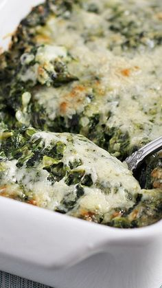 Ina Garten's Creamed Spinach Gratin. Michelle's notes: made for Thanksgiving 2015. YUM. I halved the recipe since there were so many sides already, but this was a winner. Might have used a little more cheese than was strictly called for, and I used grated parmesan instead of freshly-grated parm, but I will definitely make this again!