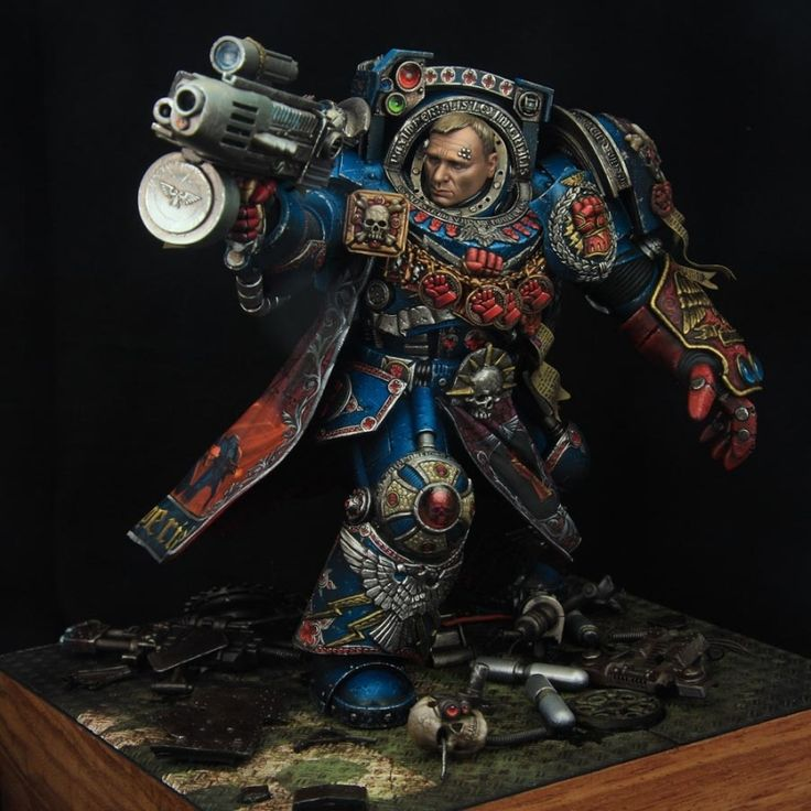 A stunning series of Crimson fists 1st company captain, and the BEST scratch build custom paint I have ever seen of a Warhammer 40K Figure.