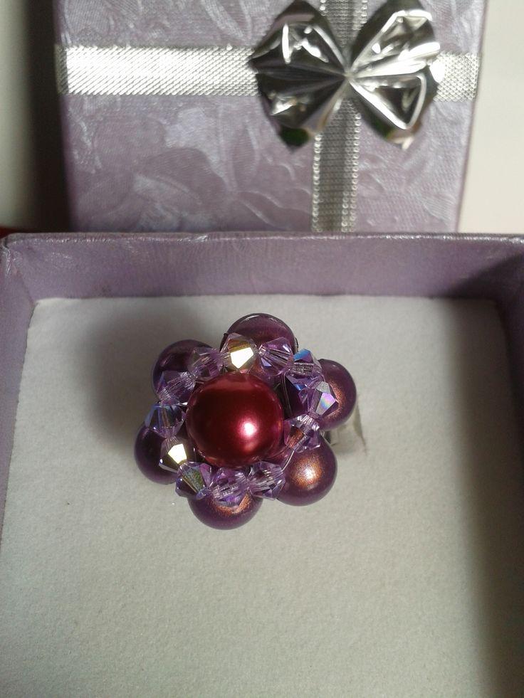 Bague métal avec des perles magiques violettes er franboise et toupies mauves