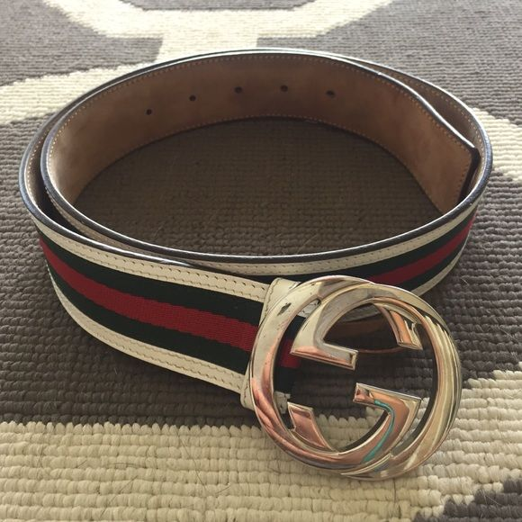 Men's Gucci Belt Selling my boyfriend's gently used Gucci belt. 3 out of 5 of the notch holes have signs of wear and the buckle has some scratches but it's in great condition. Classic white, green, and red colors. Actual belt measures about 37inches. See additional post for more pictures. Comment for questions and/or place an offer using the button below! No trades. Gucci Accessories Belts