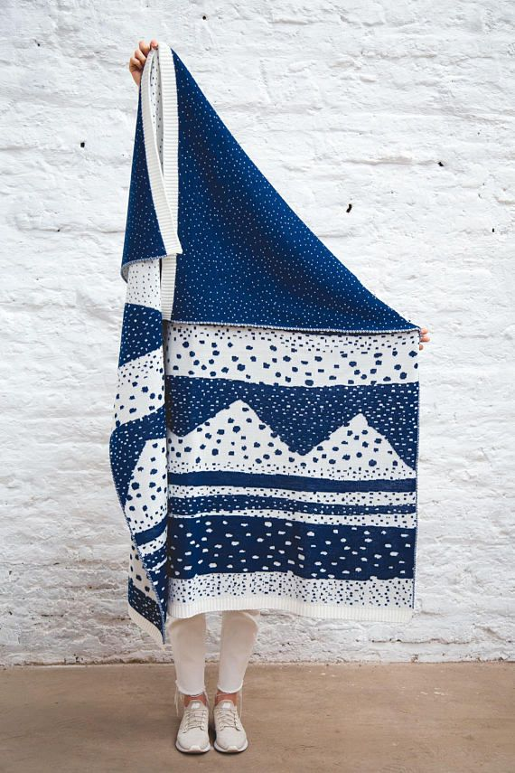 Inspired by Cordillera de Los Andes this beautiful blanket its a tribute to Chiles geography: the sea, the mountains, volcanos and the starry sky. Fully reversible, its modern design makes it ideal for the lounge room or bedroom. Use it over your bed, couch, sofa or chair for a warm and hip touch. This blanket will keep you warm and happy. Size: W 125 x L 150 cm / 49 W x 59 L Material: Wool Blend, high performance fiber. Care instructions: Hand wash in neutral soap or Dry Clean. Do not u...