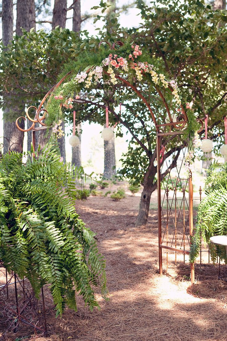 Quick Backyard Wedding Ideas : Outdoor wedding decorated with sword fern + iron arch decorated with