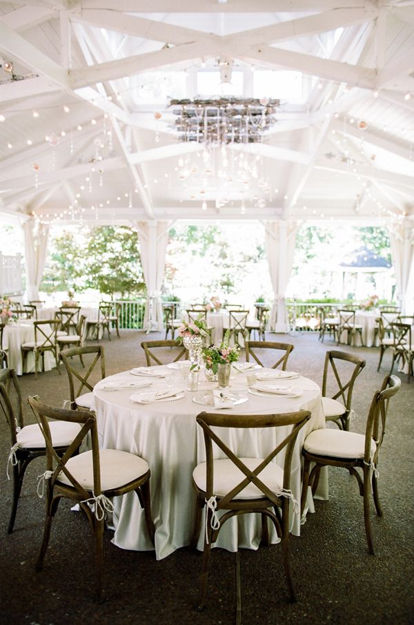 Love the cross back chairs and champagne satin linens from @southernevents. Mixed mercury glass containers help mixed florals in shades of pink, peach, white and ivory. Soooo pretty!  CJ's Off the Square | Nashville Garden Wedding Venue