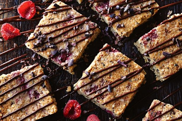 An easy gluten-free slice packed with the goodness of quinoa, raw cacao and studded with raspberries.