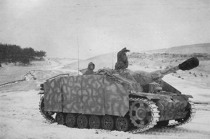 A StuH 42 with scherzen panels in winter conditions