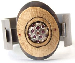 """""""Titanium Bracelet"""" by Eric Silva, made of titanium, antler, sterling silver and rubies."""