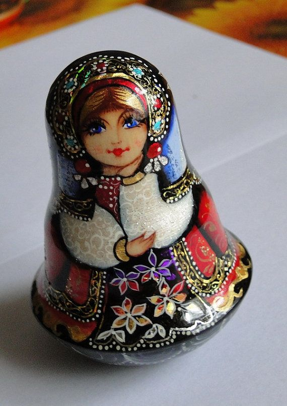 Russia matryoshka (means nesting dolls) with a beautiful face and painted in vivid colours. I should think the finishing laquer is done by dipping.