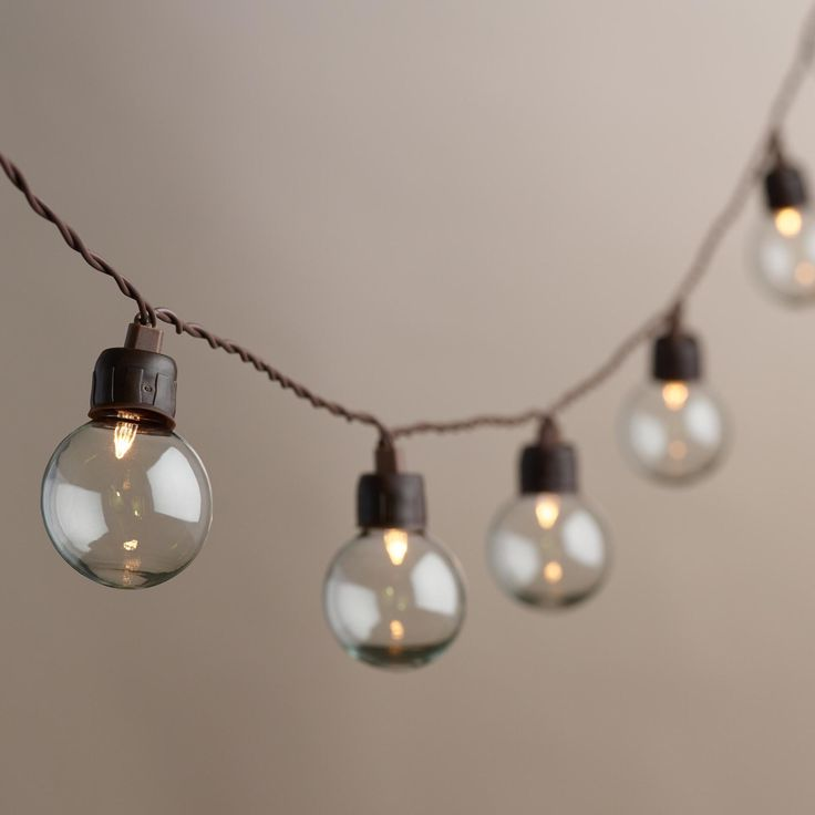 Featuring 20 clear round bulbs housing warm white LED lights, our exclusive solar-powered string lights do away with restrictive cords and battery packs - all they need to shine is a charge from the sun.