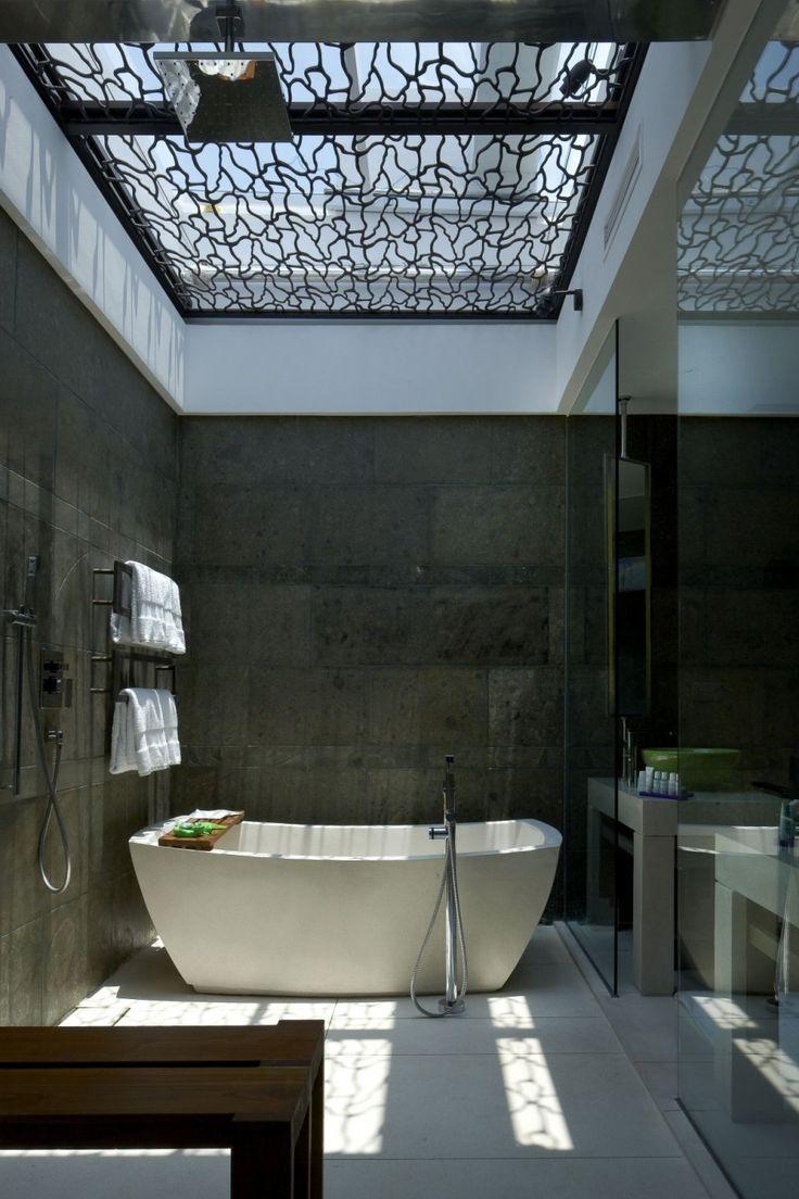 Bathtub with wrought iron sky light