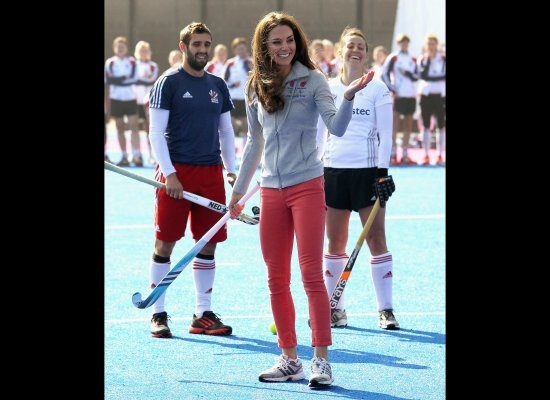 Kate plays field hockey with members of Great Britain's Olympic team