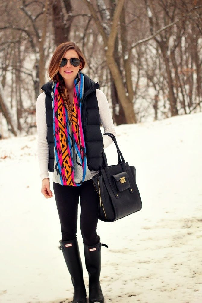 Try pairing a black quilted vest with black leggings for an unexpectedly cool ensemble. Rock a pair of black rain boots for a more relaxed aesthetic.  Shop this look for $167:  http://lookastic.com/women/looks/sunglasses-rain-boots-leggings-tote-bag-scarf-vest-v-neck-sweater/6334  — Black Sunglasses  — Black Rain Boots  — Black Leggings  — Black Leather Tote Bag  — Multi colored Geometric Scarf  — Black Quilted Vest  — White V-neck Sweater