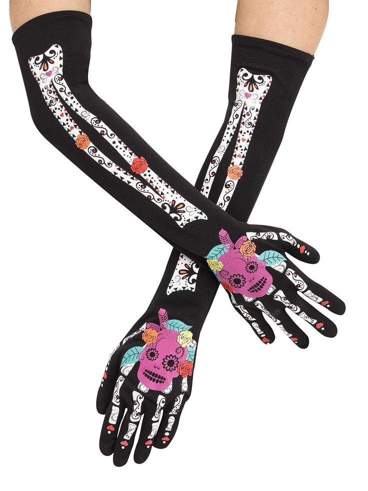 Diese Tag der Toten Skelett-Handschuhe Sugar Skull schwarz-bunt aus unserer Kategorie Halloween Handschuhe werden jede Dame in eine echte Skelett-Lady verwandeln. Perfekt für Halloween oder schaurige Kostümpartys und vielseitig kombinierbar zu jedem Kostüm!