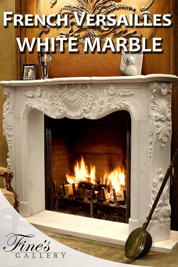 French Versailles inspired white marble fireplace surround.