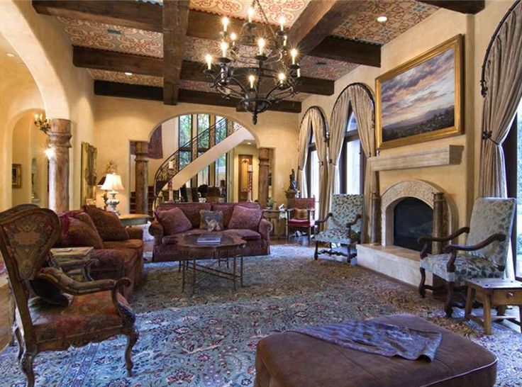 An Iron Railed Staircase With Hardwoods And Arched Doorways Beckons You To  The Old World Charm Of This Tuscan Style Home. This Tuscan.