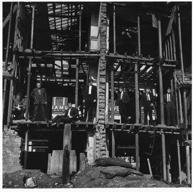 McCullin's first-ever published photograph, The Guv'nors, captures a gang from Finsbury Park, London, outside a dilapidated house. It was first published in the Observer in 1958 after a policeman was murdered by one of the gang members