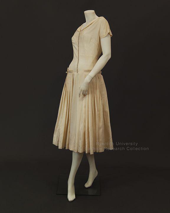 Cream silk wedding dress with cap sleeves, drop waist pleated panel skirt, 1955, Label: LISA Gowns, Toronto, FRC2005.02.001