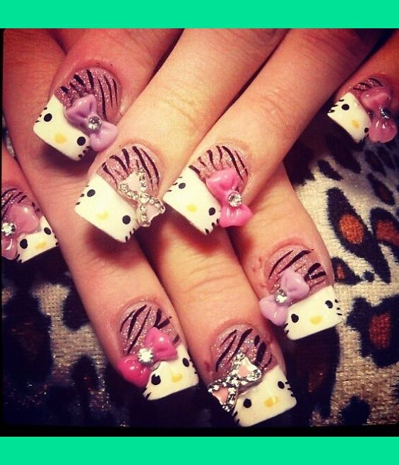 Hello Kitty nails. 3D bows and rhinestones cute but a little to out of control for me!!!