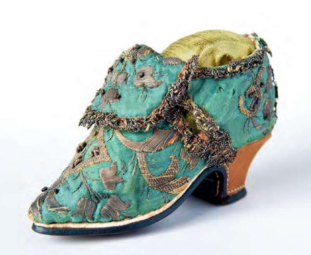 Sample shoe, c.1700, European. Measuring just four inches long and under three inches high, this miniature shoe perfectly replicates a full-scale woman's pump. Fully finished with a lining of white kid and linen, this shoe was probably never meant to be worn, even by a small child. Instead, this shoe was likely designed by a master shoemaker as a sample for his journeymen to copy or to show clients.    Cora Ginsburg catalog 2015