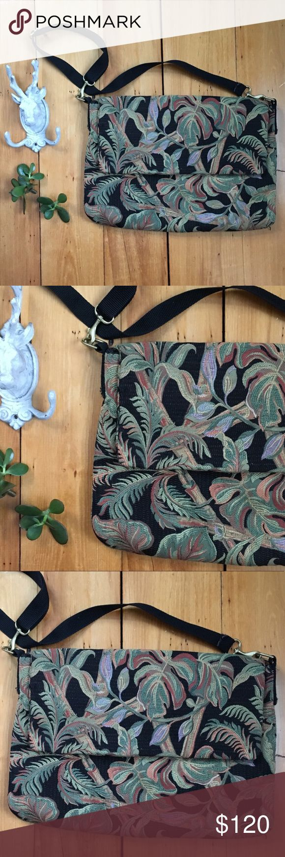 Vintage Floral Leaf Fabric Handmade Laptop Bag A beautiful handmade piece! Fully lined with a few interior pockets. Sturdy adjustable black fabric  strap with silver tone hardware. Black green and orange and purple tropical plant floral vintage fabric paired w a fun yellow brown vintage inside lining fabric. One small pen stain on inside. Outside has no issues to note. A funky way to carry your comp!  Measurements to come 😊 Vintage Bags Laptop Bags