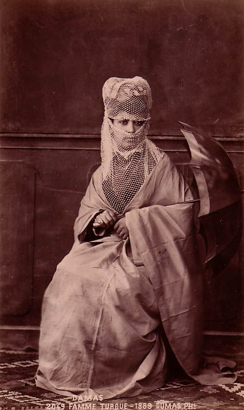 A Turkish woman of Damascus, in outdoor dress.  Late-Ottoman era, end of 19th century.