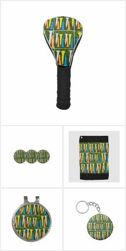 Colourful golf tees are on green grass. #golfgifts