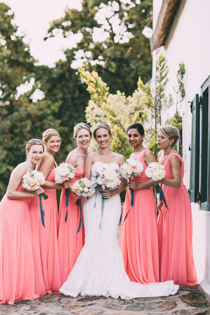Country wedding. Coral bridesmaid dresses. Coral and teal. Image by Kristi Agier