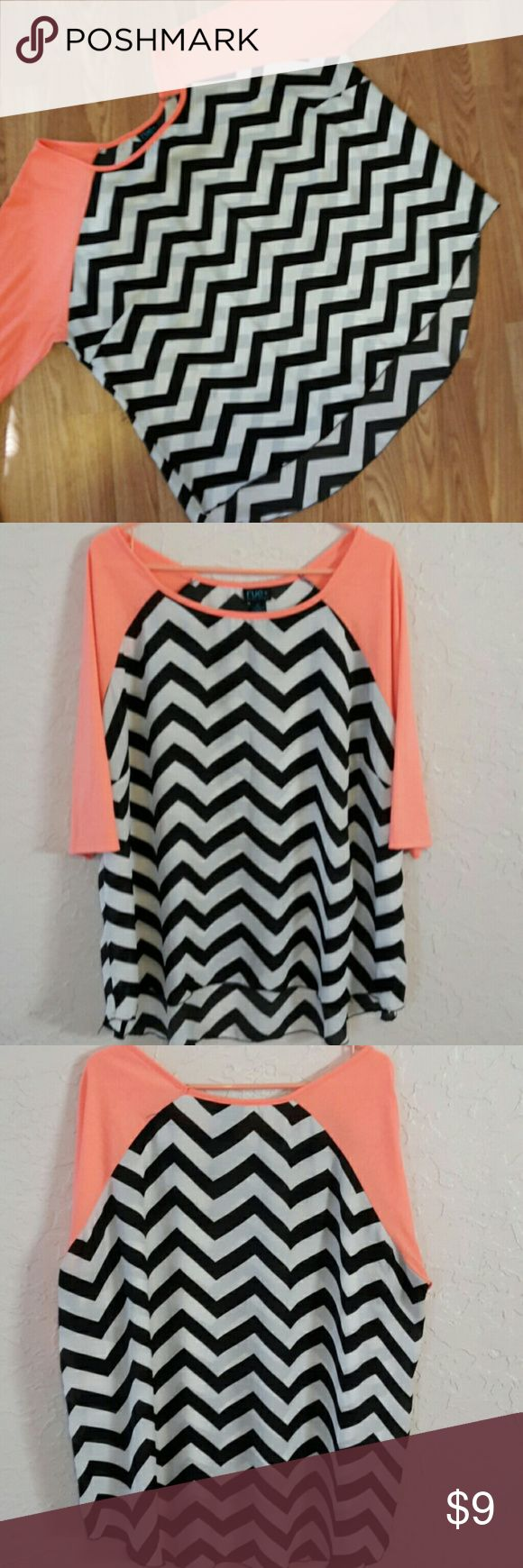 RUE+PLUS SIZES 3X CHEVRON BLOUSE Bright orange, black, white chevron print, hi-low, 3/4 sleeve, blouse with alot of flow and movement. Knit 100%  rayon. Woven 100% polyester. Has some piling under arms. This will reflect in price. rue+ Tops Blouses