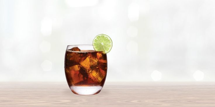 Smirnoff Vanilla Vodka & Cola | 1.5 OZ. SMIRNOFF® VANILLA 3 OZ. COLA 1 LIME WEDGE(S) FILL GLASS WITH ICE + ADD SMIRNOFF® VANILLA AND COLA + STIR WELL AND GARNISH WITH LIME.