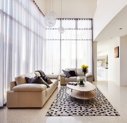The high ceiling in the lounge room unites the ground floor and second storey uniquely, with a visible void overpass creating an exciting feature in this home.