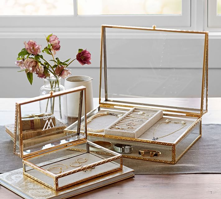 """Antique Gold Jewelry Boxes, USD $79 – $129, A fine filigree pattern on the gold trim adds glimmer and texture to our boxes. They're ideal for displaying favorite jewelry or small mementos, and make a welcome gift. They can be monogrammed or personalized with a name. Small: 8.5"""" wide x 6"""" deep x 3.25"""" high Large: 13.25"""" wide x 10"""" deep x 4.5"""" high Made of steel with an antique golden brass finish."""