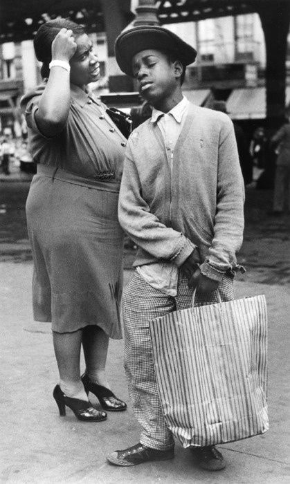 Boy shopping with his mother on Ninth Ave. New York, 1938. By Morris Engel