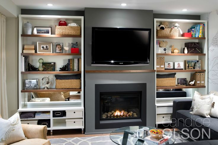 Both the fireplace and the TV are the focal point in this family room. #fireplace #candiceolson