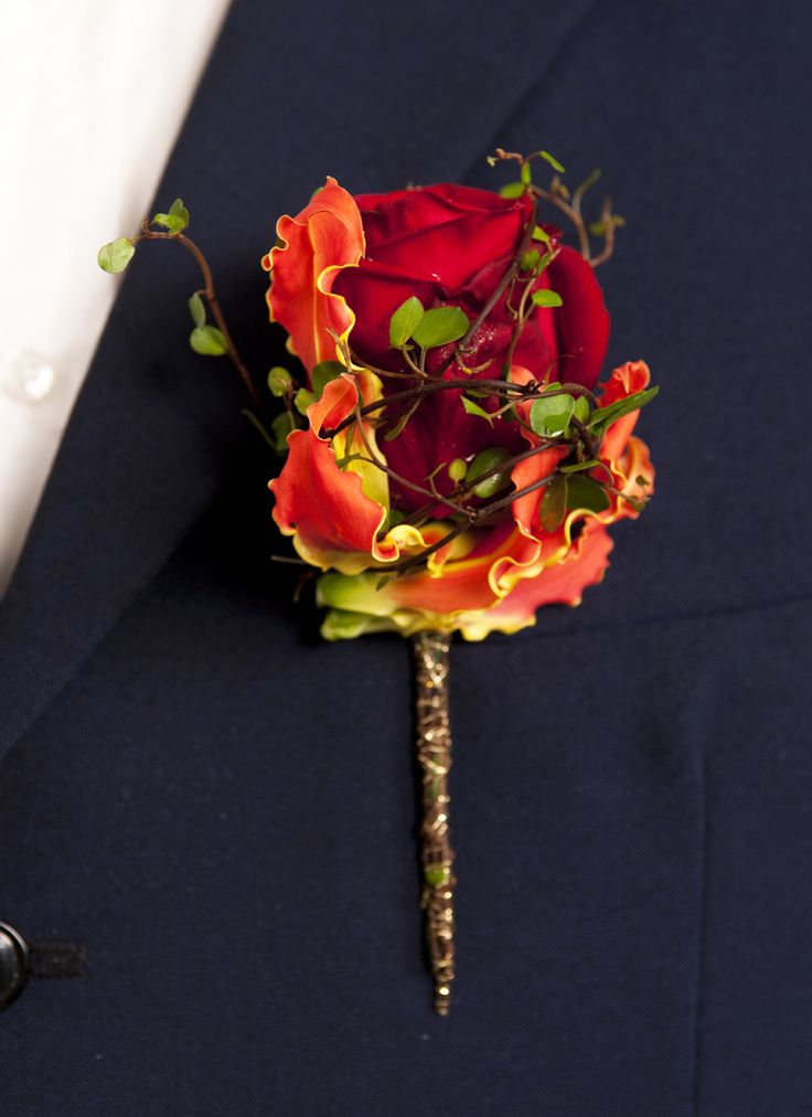 Wildwood Boutonniere~ red rose, gloriosa lily and angel vine