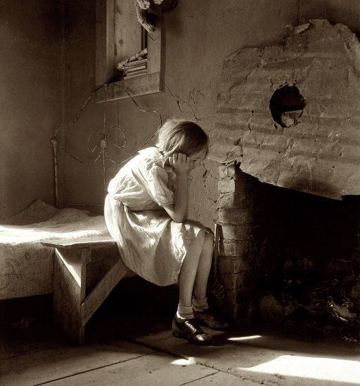 """Dorothea Lange - 1935 - New Mexico - Resettled Farm Child From Taos Junction to Bosque Farms project, New Mexico."""" View full size. Medium-format nitrate negative by Dorothea Lange for the Resettlement Administration."""