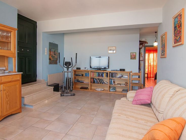 Panormos apartment rental - Books, DVDs, CDs, a guitar and even a cross trainer are available!