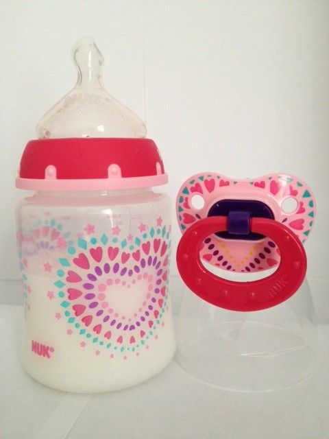Reborn Magnetic Pacifier and Baby Doll Bottle with Faux Milk by Nuk.  Comes with nipple cover.  Milk does not flow into the nipple and the bottle is sealed at the neck.  Pacifier comes either with or without the magnet.  You choose.