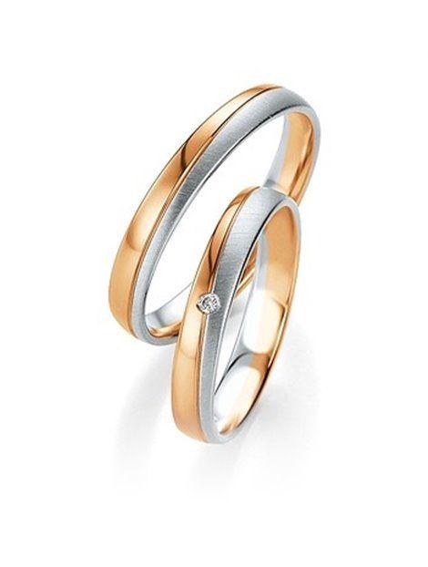 Βέρες Γάμου BREUNING-BENZ Χρυσές 8K Δίχρωμες με Διαμάντια Αναφορά 014037 Ζευγάρι βέρες γάμου BREUNING-BENZ από Χρυσό Κ8 σε λευκό και ροζ χρώμα. Η γυναικεία βέρα είναι διακοσμημένη με πολύτιμη λευκή πέτρα (μπριγιάν). Και οι δύο βέρες έχουν εσωτερική ανατομική εφαρμογή.