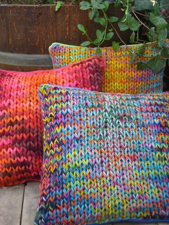 Pretty knit pillows. Big needles, several strands of yarn.