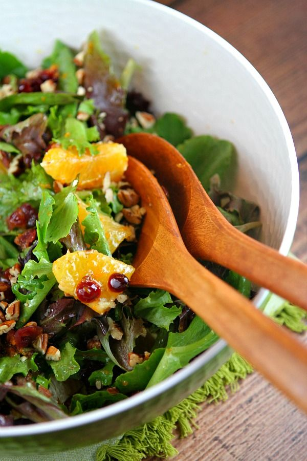 Recipe for Mixed Green Salad with Oranges, Dried Cranberries and Pecans. Dairy free, gluten free and vegan.