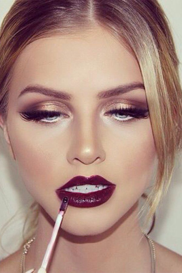 Trendy look, have seen a ton of dark lips with gold eyes this year!