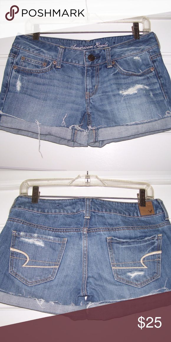 American Eagle Denim SHORTS *Vintage Finish* Eye-catching pair of ladies denim shorts by American Eagle, size 2. Blue denim features a vintage finish--they have a worn appearance with rubs and holes. Rolled cuff can be unfurled should you prefer an uncuffed leg. 100% cotton. Gently used condition. American Eagle Outfitters Shorts Jean Shorts
