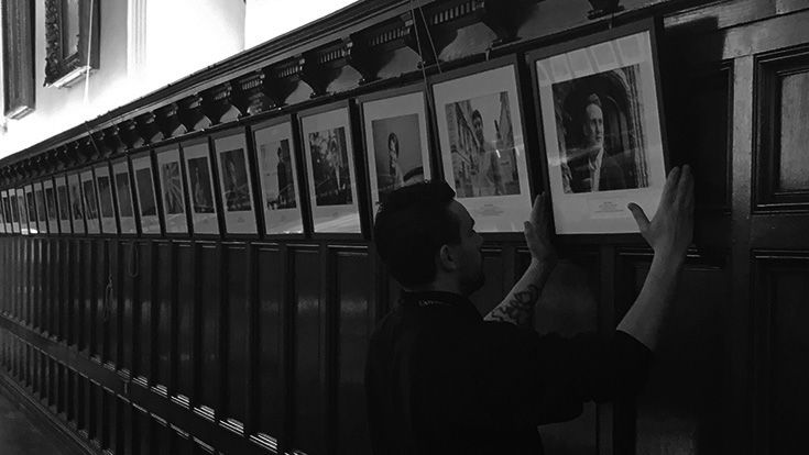 Hanging the portraits in Hall ahead of the Young Univ Gallery launch event.